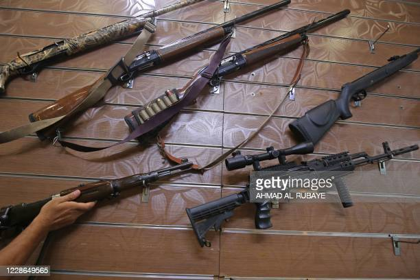 Rifles are displayed for sale at a gun shop in the Iraqi capital Baghdad on September 22, 2020.