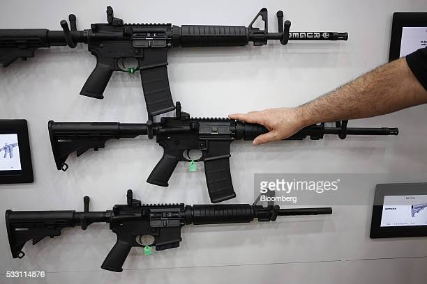 Rifles are displayed on the exhibit floor during the National Rifle Association annual meeting in Louisville, Kentucky, U.S., on Friday, May 20,...
