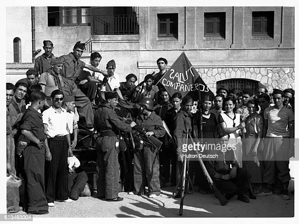 Rifles are distributed to anarchist and syndicalist soldiers at Barcelona during the Spanish Civil War | Location Barcelona Spain