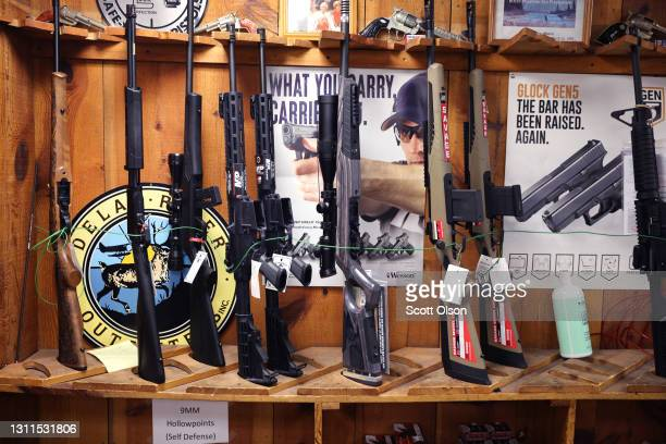 Rifles are offered for sale at Freddie Bear Sports on April 08, 2021 in Tinley Park, Illinois. President Joe Biden today announced gun control...