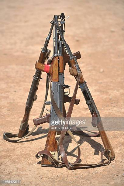 AK47 rifles are stacked on a shooting range during a shooting course taught by US Marines at Camp Leatherneck in Helmand Province on June 19 2012 The...