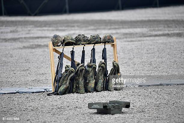 G36 rifles helmets and bulletproof vests of German soldiers stand in a compound during the 'Land Operations' military exercises during a media day at...