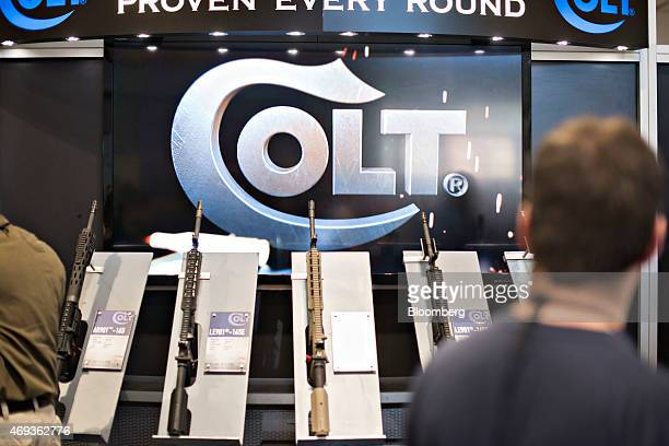 Rifles sit on display in the Colt's Manufacturing Co booth on the exhibition floor of the 144th National Rifle Association Annual Meetings and...