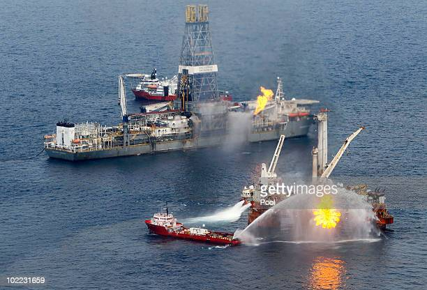 A rig burns oil and gas near the Discoverer Enterprise at the site of the Deepwater Horizon oil spill on June 19 2010 in the Gulf of Mexico The BP...