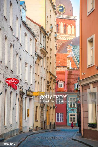 riga cathedral and alley - riga stock pictures, royalty-free photos & images