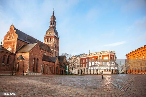 riga cathedral and the square in the morning - riga stock pictures, royalty-free photos & images