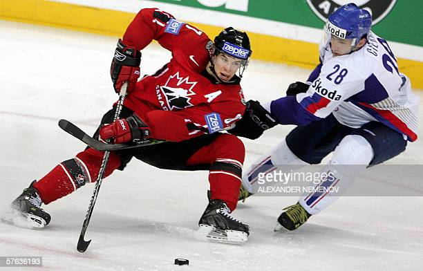 Canadian Sidney Crosby fights for the puck with Slovakia's Ivan Ciernik during their quarter-final match of the Ice Hockey World Championship in...