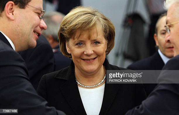 German Chancellor Angela Merkel smiles upon arriving to attend the Nato Summit working session in Riga Latvia 29 November 2006 Leaders from the 26...