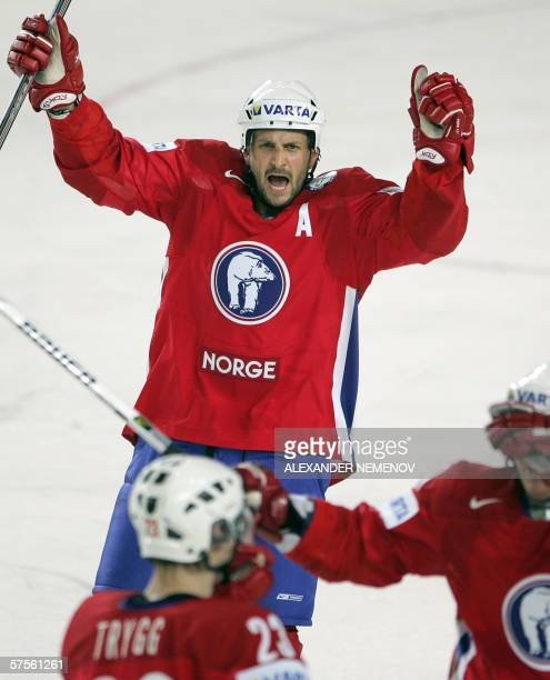Norwegian players jubilate after scoring against the Danish team during their preliminary round group D match of the Internetional Ice Hockey World...