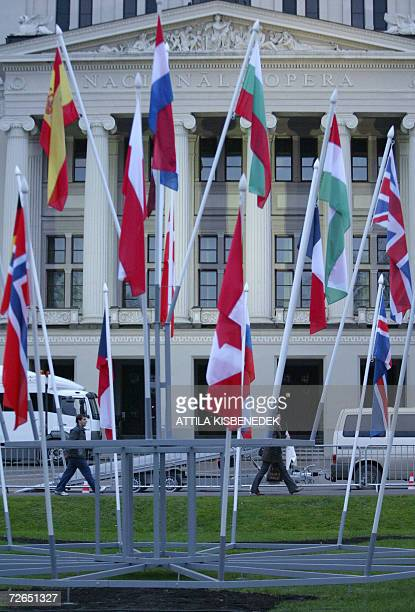 Picture taken 27 November 2006 shows flags in front of Riga's Opera House Latvia on the eve of the start of the Nato Summit NATO leaders will debate...