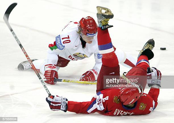 Russia's Alexander Ovechkin fights for the puck with Belarus' Uladzimir Denisov during their preliminary round group C match of the Internetional Ice...