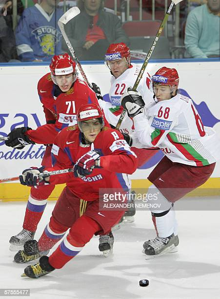 Russia's Evgeni Malkin and Alexander Ovechkin fights for the puck with Belarus' Sergei Zadelenov and Yaroslav Chupris during their preliminary round...