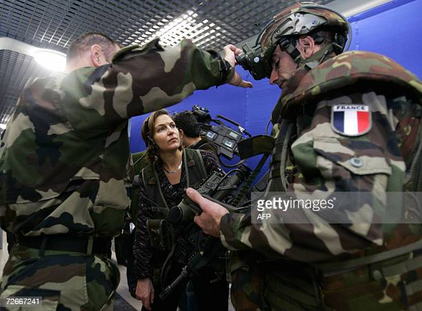 Victoria Nuland , US ambassador to Nato, listens to Ltd Colonel Peloux of the French Army Technical Section during an New Army Equipment exhibition...
