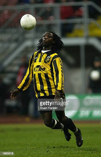 Riga Mustapha of Vitesse Arnhem looks to bring the ball under control during the UEFA Cup second round second leg match between Werder Bremen and...