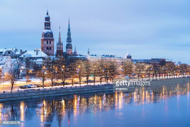 riga towers in winter - latvia stock pictures, royalty-free photos & images