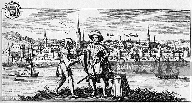 Riga view of the city on the bank of the river Daugava c 1700 Caption reads 'Riga in Lieflande' In foreground jester man and young girlEngraving from...