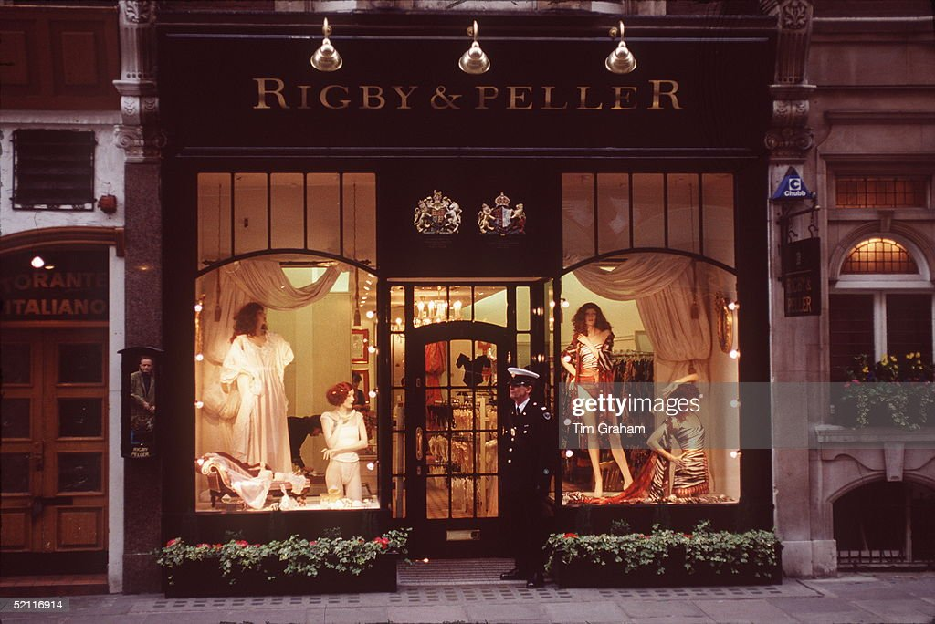 Rigby & Peller Shop In London Showing Royal Warrant Above The Doorway Circa 1990s. They Have A Warrant From The Queen As Corsetieres. A Uniformed Security Person Stands Guard.
