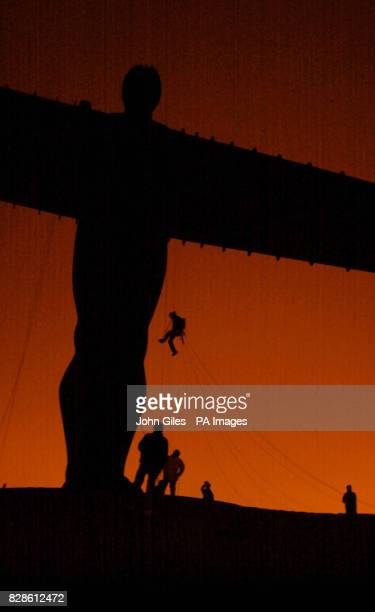A rigger climbs the Angel of the North as prohunting campaigners hang a huge banner from Britain's largest sculpture as an early Valentine's message...
