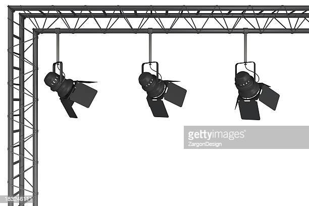 A rigging with 3 stage lights hanging from it