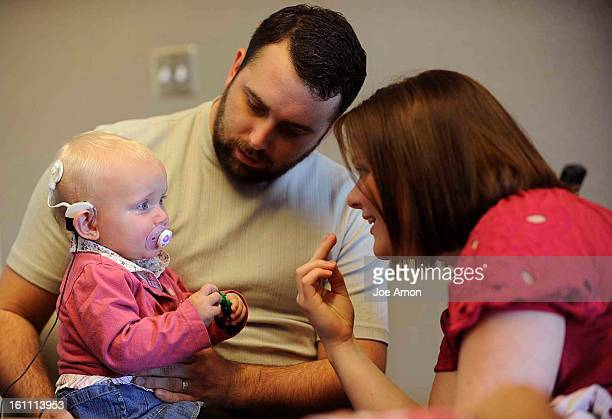 Riggs family Justin 25 Meghan 24 4 year old Miles and his baby sister 1 year old Eva at Children's Hospital as Jennifer Kolb audiologist activates...