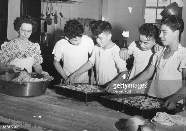 JUL 27 1950 ***** right amount of hard work and recreation Three boys are learning the tailor's trade and help stitch the bedding for the students at...