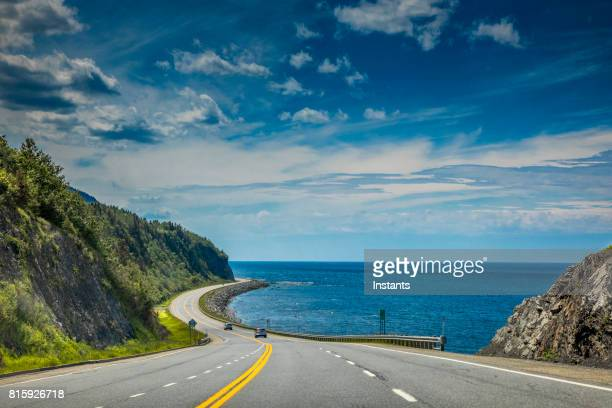 right by the saint lawrence river, a look at beautiful quebec route 132, near cap-au renard (la martre) in haute-gaspésie, situated in the eastern part of the canadian province. - canada imagens e fotografias de stock