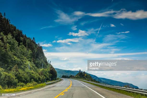 right by the saint lawrence river, a look at beautiful quebec route 132, near cap-au renard (la martre) in haute-gaspésie, situated in the eastern part of the canadian province. - gaspe peninsula stock pictures, royalty-free photos & images
