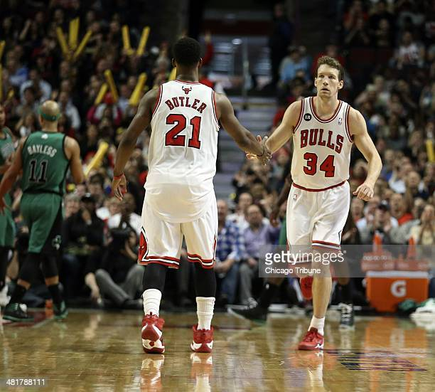 Right Chicago Bulls forward Mike Dunleavy with Chicago Bulls guard Chicago Bulls forward Mike Dunleavy right is congratulated by Chicago Bulls guard...