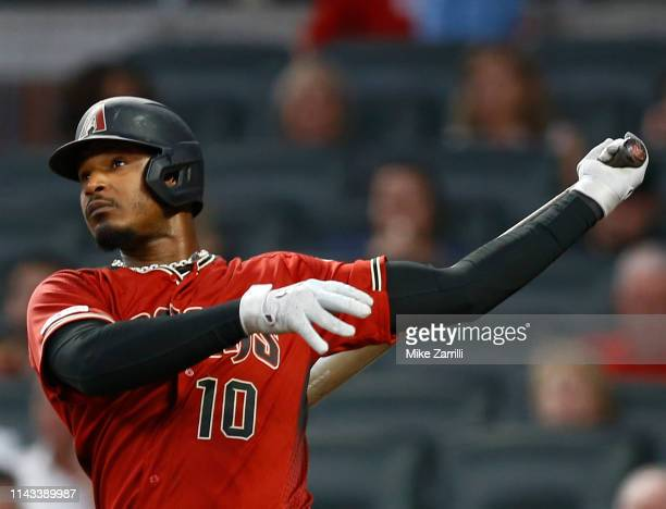 Right fielder Adam Jones of the Arizona Diamondbacks hits a solo home run in the fourth inning during the game against the Atlanta Braves at SunTrust...