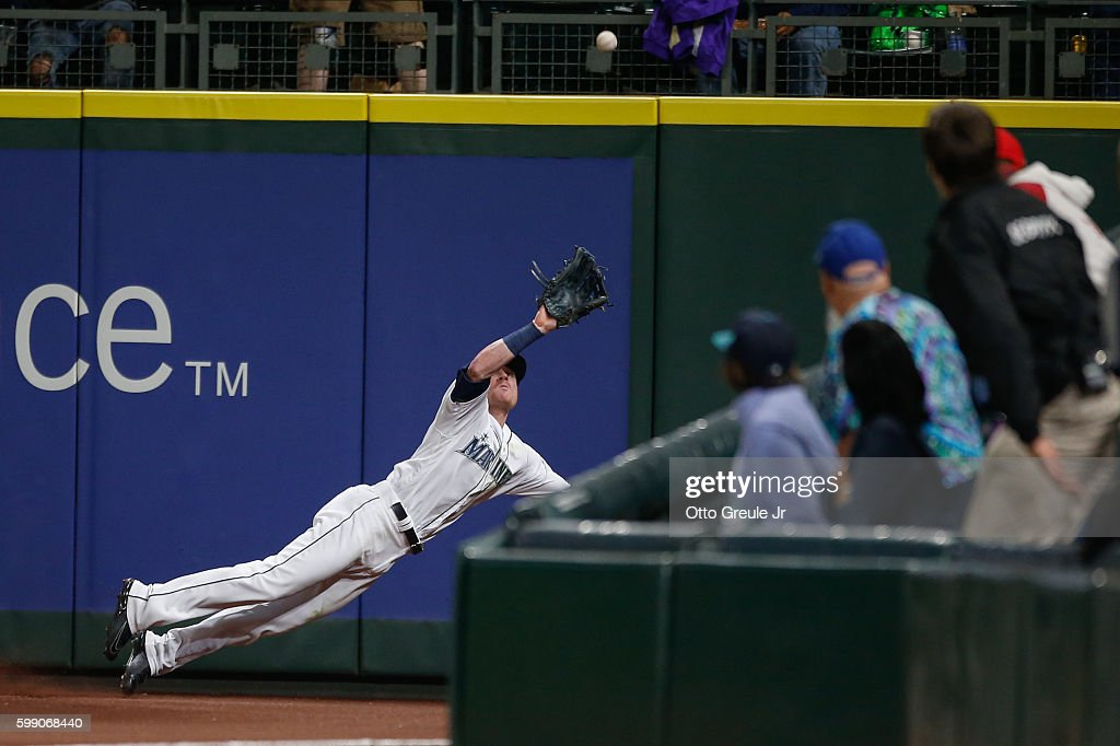Right fielder Ben Gamel #16 of the Seattle Mariners makes a diving catch on a ball off the bat of C.J. Cron of the Los Angeles Angels of Anaheim in the ninth inning at Safeco Field on September 3, 2016 in Seattle, Washington.