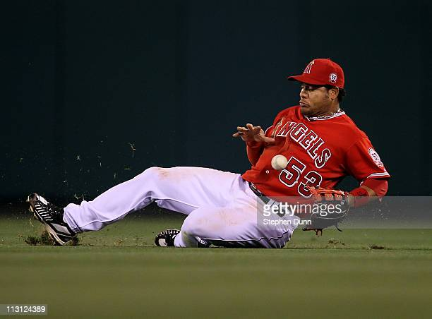 Right fielder Bobby Abreu of the Los Angeles Angels of Anaheim slides back can't reach a single hit by JD Drew of the Boston Red Sox on April 23 2011...