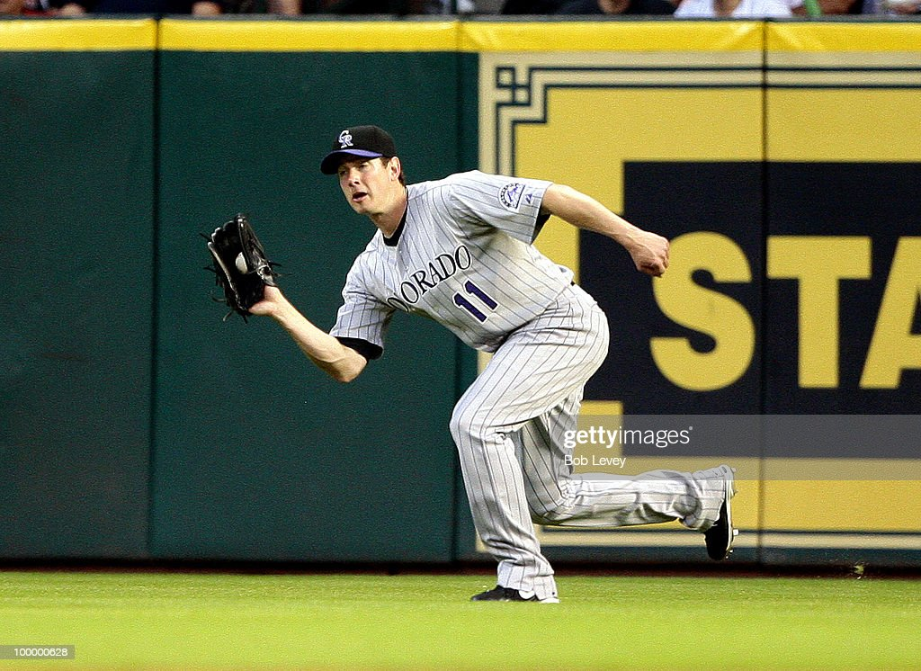 Right fielder Brad Hawpe #11 of the Colorado Rockies makes a catch on a dipping fly ball against the Houston Astros at Minute Maid Park on May 19, 2010 in Houston, Texas.