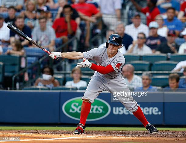 Right fielder Brock Holt of the Boston Red Sox swings during the game against the Atlanta Braves at Turner Field on June 17 2015 in Atlanta Georgia