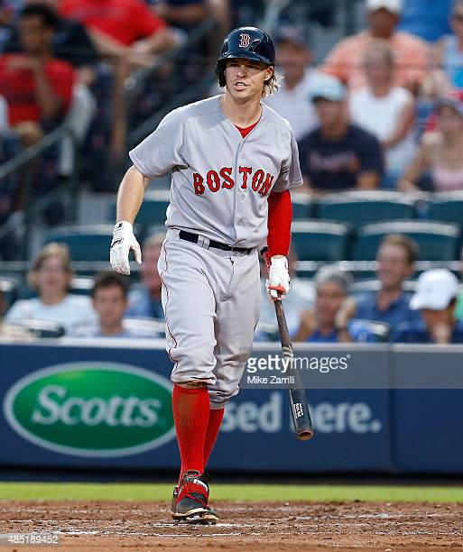 Right fielder Brock Holt of the Boston Red Sox walks to the dugout during the game against the Atlanta Braves at Turner Field on June 17 2015 in...