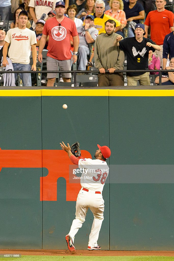Right fielder Chris Dickerson #38 of the Cleveland Indians catches a fly ball hit by Steve Pearce #28 of the Baltimore Orioles during the ninth inning at Progressive Field on August 16, 2014 in Cleveland, Ohio. The Indians defeated the Orioles 6-0.
