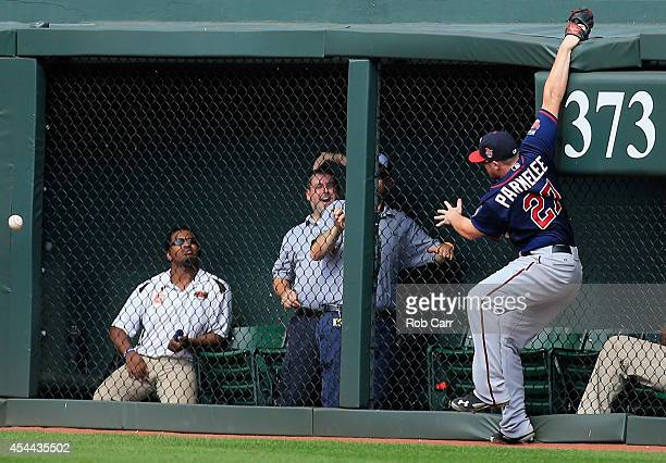 Right fielder Chris Parmelee of the Minnesota Twins goes up for a triple hit by Ryan Flaherty of the Baltimore Orioles during the sixth inning at...