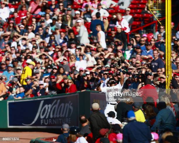 Right fielder Chris Young of the Boston Red Sox makes a catch at the top of the second inning during the game against the Houston Astros at Fenway...