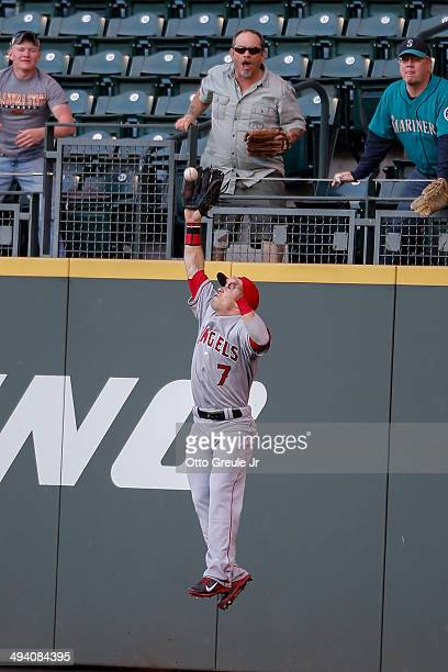 Right fielder Collin Cowgill of the Los Angeles Angels of Anaheim catches a fly ball off the bat of Michael Saunders of the Seattle Mariners in the...