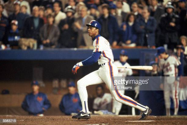 Right fielder Darryl Strawberry of the New York Mets swings during game 7 of the 1986 World Series against the Boston Red Sox at Shea Stadium on...