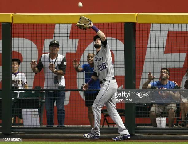 Right fielder David Dahl of the Colorado Rockies makes a catch on the warning track on a ball hit by Eduardo Escobar of the Arizona Diamondbacks...