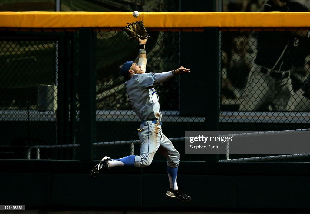 Right fielder Eric Filia #4 of the UCLA Bruins makes a leaping catch on a fly ball by Nick Ammirati #17 of the Mississippi State Bulldogs during the fifth inning of game one of the College World Series Finals on June 24, 2013 at TD Ameritrade Park in Omaha, Nebraska. UCLA won 3-1.