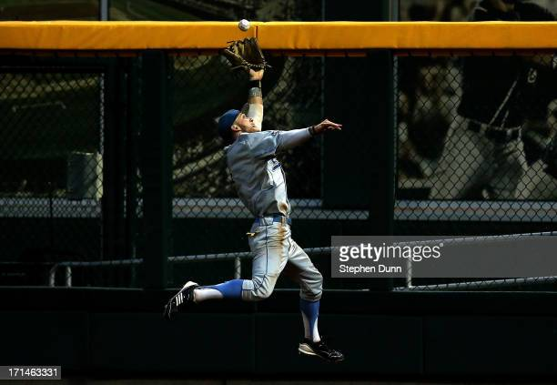 Right fielder Eric Filia of the UCLA Bruins makes a leaping catch on a fly ball by Nick Ammirati of the Mississippi State Bulldogs during the fifth...