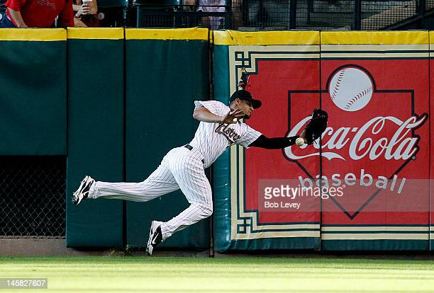 Right fielder Fernando Martinez of the Houston Astros makes a diving attempt to catch a ball hit by Carlos Beltran of the St Louis Cardinals in the...