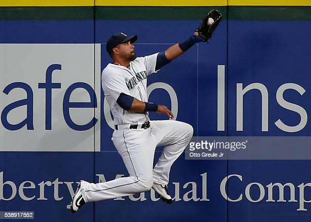 Right fielder Franklin Gutierrez of the Seattle Mariners catches a fly ball off the bat of Juan Uribe of the Cleveland Indians in the sixth inning at...