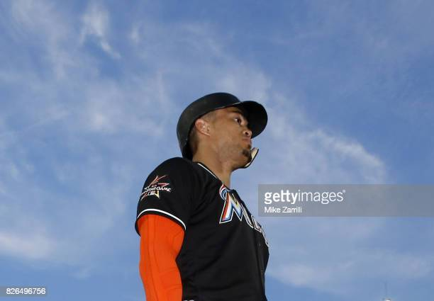 Right fielder Giancarlo Stanton of the Miami Marlins walks on the field in the third inning during the game against the Atlanta Braves at SunTrust...