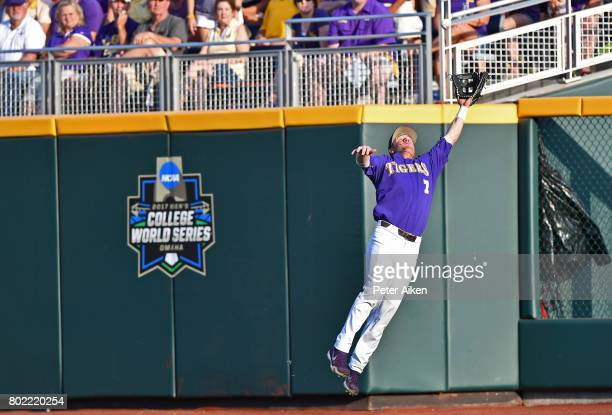 Right fielder Greg Deichmann of the LSU Tigers makes a leaping catch against the Florida Gators in the first inning during game two of the College...