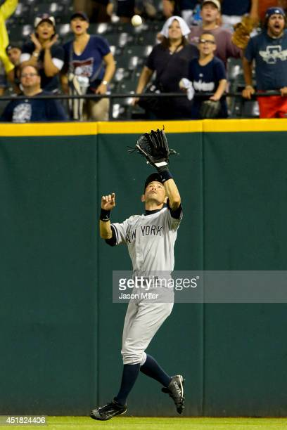 Right fielder Ichiro Suzuki of the New York Yankees catches a fly ball hit by Nick Swisher of the Cleveland Indians to end the game at Progressive...