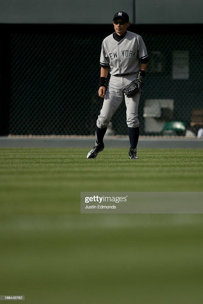 Right fielder Ichiro Suzuki #31 of the New York Yankees prepares for the pitch against the Colorado Rockies at Coors Field on May 9, 2013 in Denver, Colorado. The Yankees defeated the Rockies 3-1 to win the series.