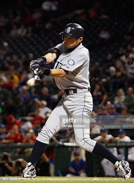 Right fielder Ichiro Suzuki of the Seattle Mariners gets his 200th hit of the season against the Texas Rangers on September 13, 2009 during game two...