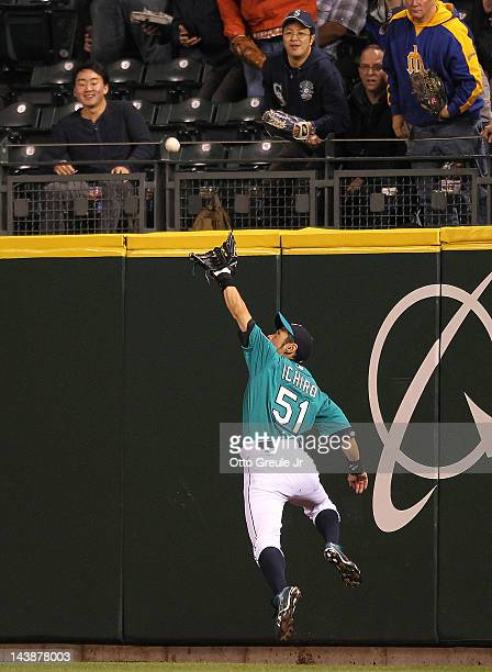 Right fielder Ichiro Suzuki of the Seattle Mariners makes a leaping catch on a ball hit by Danny Valencia of the Minnesota Twins at Safeco Field on...